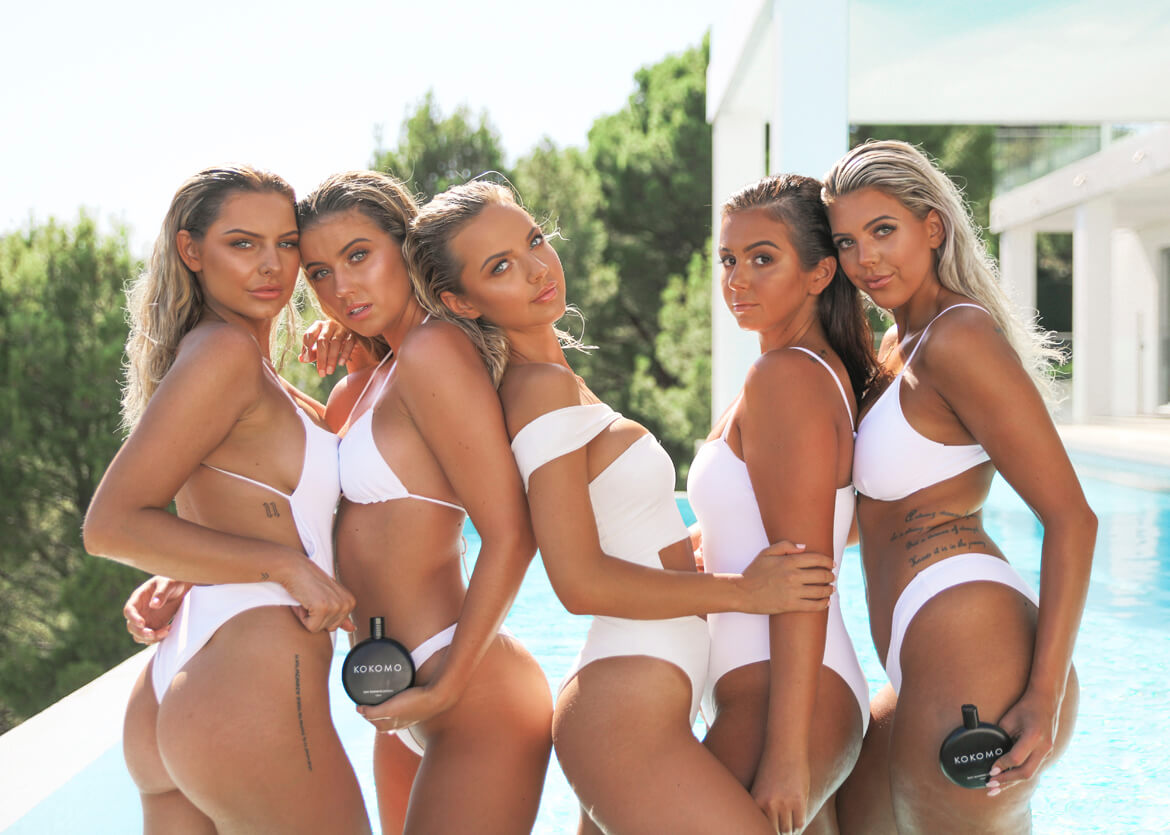 Kokomo Tanning Lotion - photo of 6 female models in white bikini's in front of swimming pool.
